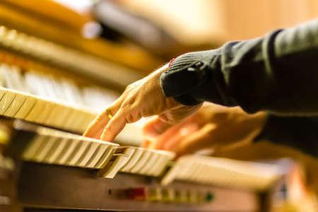 male hands playing organ keyboard in church Stock Photo