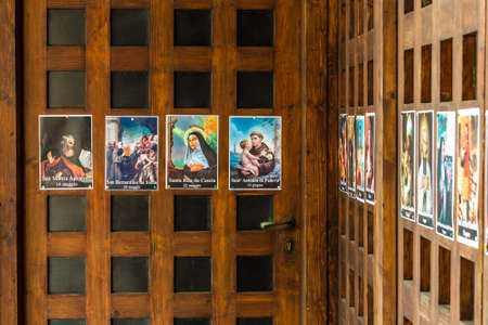 SAN BERNARDINO (RA), ITALY – OCTOBER 31, 2018: The priest put on the entrance of the church the images of the Saints to remind the religious connotation of Halloween Foto de archivo - 115508870