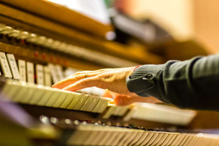 male hands playing organ keyboard in church Archivio Fotografico