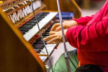 male hands playing organ keyboard in church Imagens