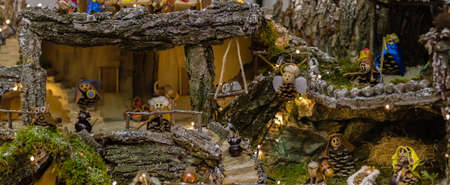 FORLI, ITALY - DECEMBER 19, 2017: lights are enlightening artistic homemade crib in the 28th edition of the Nativity Scenes Exhibition