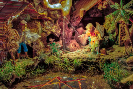 LONGIANO (FC),ITALY - DECEMBER 29, 2017: lights are enlightening artistic Christmas crib in the 27th edition of the Nativity Scenes Exhibition Editorial