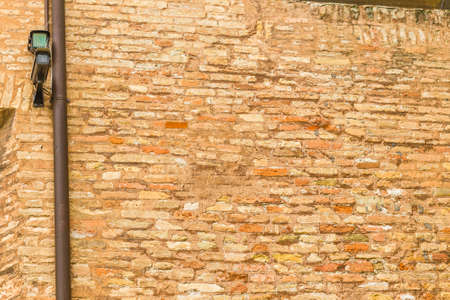 Surveillance cameras with pigeon Dissuader on ancient walls Stock Photo