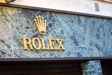 RAVENNA, ITALY - SEPTEMBER 12, 2018: light is enlightening  ROLEX logo on storefront