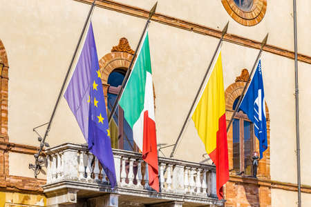 RAVENNA, ITALY: flags waving from balcony of city hall
