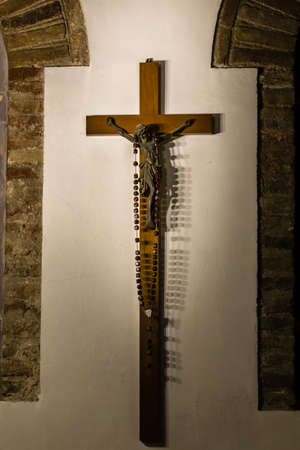 Rosary Beads on Crucifixion of Jesus Christ