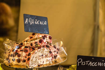 LUGO (RA), ITALY: light is enlightening slices of Amarena cake for sale in touristic french market Stockfoto
