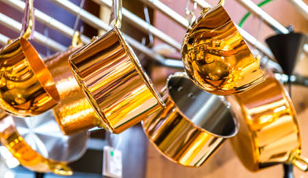 copper pots dangling from the ceiling Stock Photo - 115556140