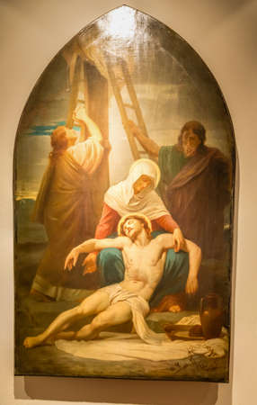 Medjugorje, Bosnia and Herzegovina - November 3, 2018: painting of Via Crucis: THIRTEENTH STATION, Jesus is taken down from the cross and given to his mother 報道画像