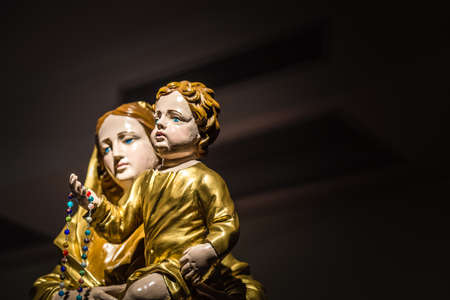 Statue of The Blessed Virgin Mary  holding Baby Jesus Editorial