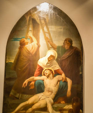 Medjugorje, Bosnia and Herzegovina - November 3, 2018: painting of Via Crucis: THIRTEENTH STATION, Jesus is taken down from the cross and given to his mother Editorial