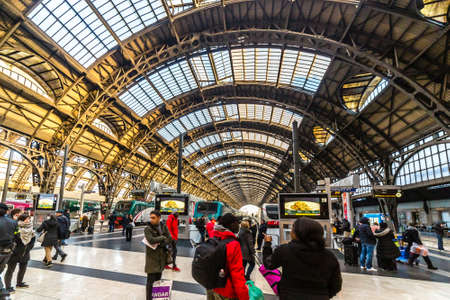 MILANO, ITALY - DECEMBER 12, 2018: travelers watching the trains departing at Milano Centrale station