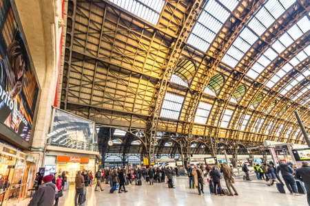 MILANO, ITALY - DECEMBER 12, 2018: travelers watching the trains departing at Milano Centrale station Editorial