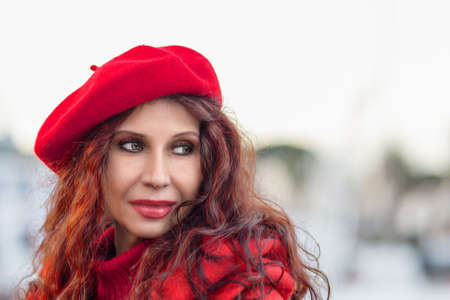 fashion woman with red hat in winter
