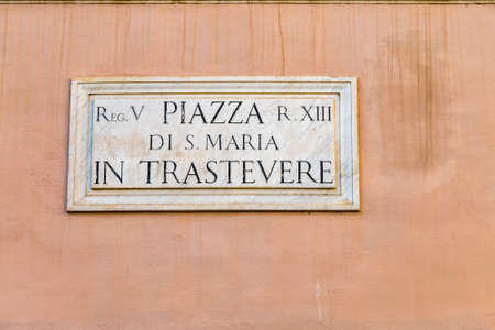 ROME, ITALY - JANUARY 2, 2019: light is enlightening  street name sign of Santa Maria in Trastevere square Editorial