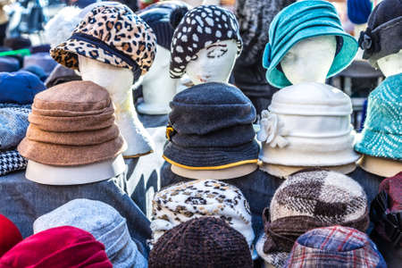 hats for sale in market stall Stock Photo