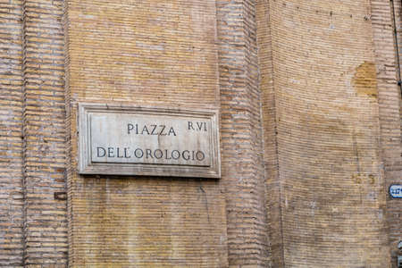 ROME, ITALY - JANUARY 2, 2019: light is enlightening  street name sign of PIAZZA DELL OROLOGIO in Rome