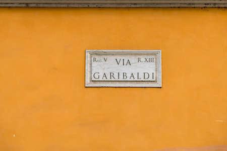 ROME, ITALY - JANUARY 2, 2019: light is enlightening  street name sign of VIA GARIBALDI in Rome