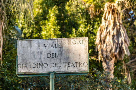 ROME, ITALY - JANUARY 2, 2019: light is enlightening  street name sign of VIALE DEL GIARDINO DEL TEATRO in Rome