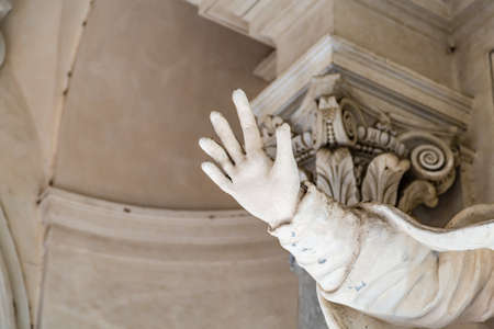 closeup of marble statue raising hand