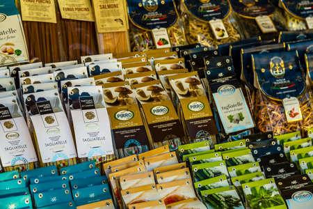 ROME, ITALY - JANUARY 6, 2019: light is enlightening bags of unusual Italian pasta for sale in street market