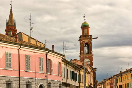 clock tower and colorful buildings in ancient hamlet of Italian village
