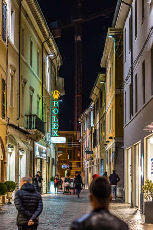 RAVENNA, ITALY - JANUARY 17, 2019: people walking in street of Ravenna at night Editorial