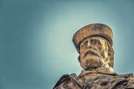 sun is enlightening the statue of Giuseppe Garibaldi Stock Photo