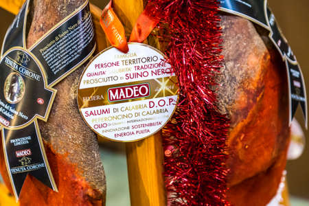 BOLOGNA, ITALY - DECEMBER 16, 2018: MADEO TENUTA CORONE is selling rare black pig ham at FICO Eataly World, the largest gourmet agri-food park in the world Editorial