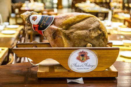 BOLOGNA, ITALY - DECEMBER 16, 2018: ANTICA ARDENGA MASSIMO PEZZANI is selling PARMA ham at FICO Eataly World, the largest gourmet agri-food park in the world 報道画像