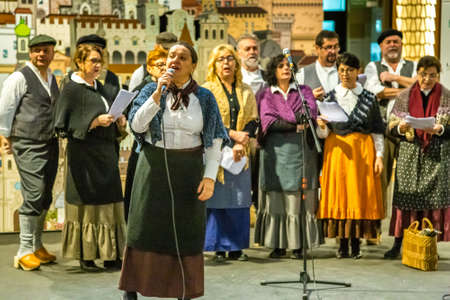 BOLOGNA, ITALY - DECEMBER 16, 2018: folk singers singing at FICO Eataly World, the largest gourmet agri-food park in the world