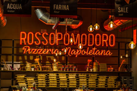 BOLOGNA, ITALY - DECEMBER 16, 2018: lights are enlightening Pizzeria sign at FICO Eataly World, the largest gourmet agri-food park in the world Editorial
