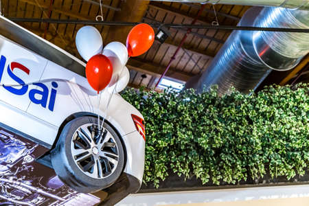 BOLOGNA, ITALY - DECEMBER 16, 2018: lights are enlightening BMW car inflatable toy advertising UNIPOLSAI at FICO Eataly World, the largest gourmet agri-food park in the world Editorial