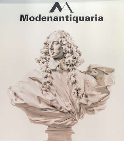 MODENA, ITALY – FEBRUARY 15, 2019:  Light is enlightening Modenantiquaria logo on signboard