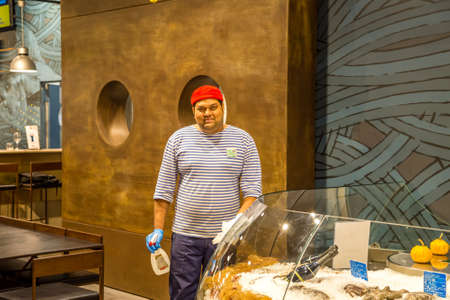 BOLOGNA, ITALY - DECEMBER 16, 2018: man cleaning glass surfaces at FICO Eataly World, the largest gourmet agri-food park in the world