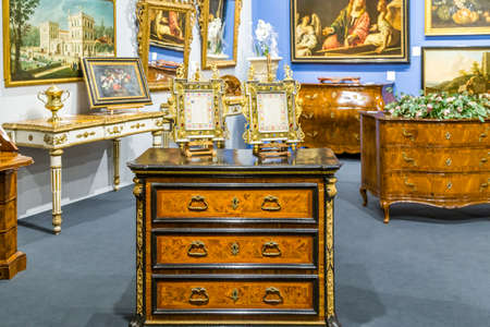 MODENA, ITALY – FEBRUARY 15, 2019: Priceless  artworks offered for sale by antique dealers during Modenantiquaria the most visited high quality antiques fair in Italy Editorial