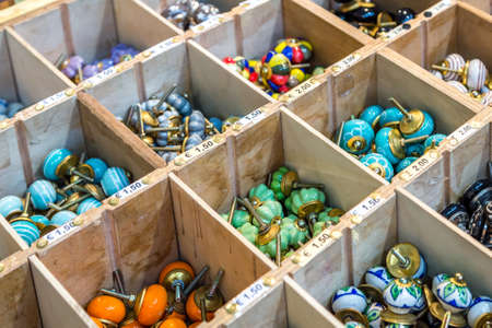CESENA, ITALY - JANUARY 20, 2019: lights are enlightening knobs for sale in Antiques Fair Foto de archivo - 117432997