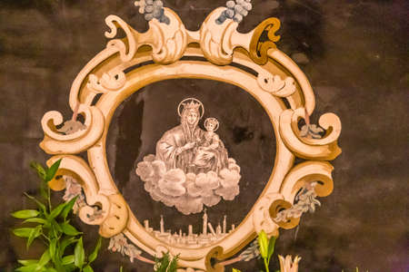 BOLOGNA, ITALY - DECEMBER 15, 2018: light is enlightening painting of the Blessed Virgin Mary and Baby Jesus in the Sanctuary of the Blessed Virgin of Saint Luke 報道画像