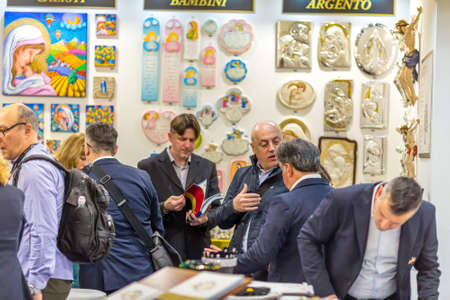 BOLOGNA, ITALY - FEBRUARY 18, 2019:  Booth presenter talking with visitors at stand LAL in DEVOTIO Religious products and service exhibition Editöryel