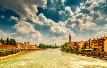 Astonishing view of the waters of the Adige River running along the ancient buildings of Verona