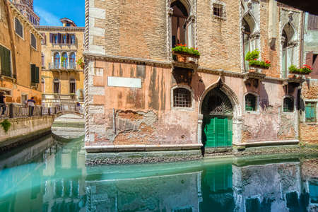 ancient buildings on typical water channel of Venezia