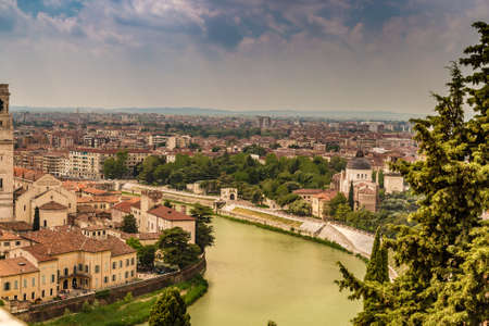 Amazing panorama of the Adige River running along ancient buildings of Verona, Italy