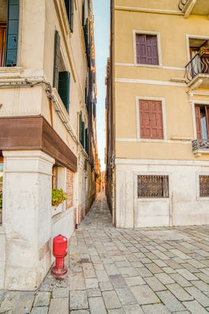 ancient buildings on typical narrow street in Venice Stock fotó