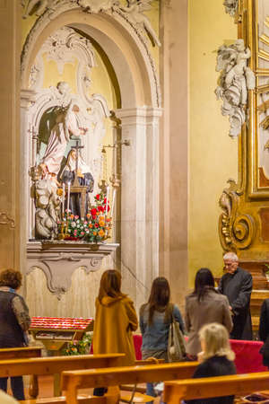 LUGO (RA), ITALY - May 22, 2019: priest blessing faithfuls in the Feast day of Saint Rita of Cascia, patron of Lost and impossible causes, of abused wives and widows