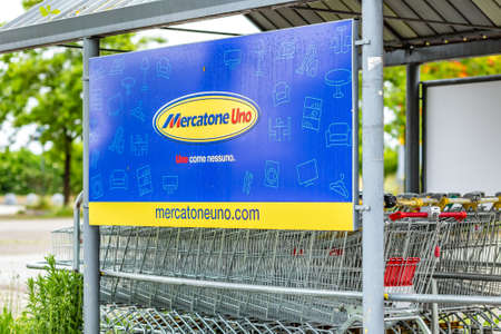 RUSSI (RA), ITALY - MAY 27, 2019: sunlight is enlightening and raindrops are covering the logo of Mercatone Uno on a gloomy day. Company went bankrupt last week Sajtókép