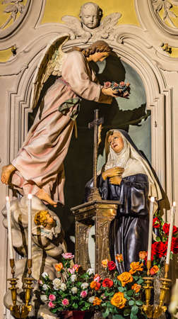 LUGO (RA), ITALY - May 22, 2019: light is enlightening Saint Rita of Cascia in her feast day welcoming pilgrims hoping intercession for solving Lost and impossible causes Banco de Imagens - 124495159