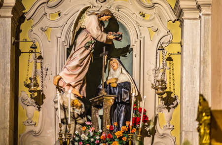 LUGO (RA), ITALY - May 22, 2019: light is enlightening Saint Rita of Cascia in her feast day welcoming pilgrims hoping intercession for solving Lost and impossible causes