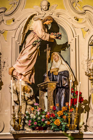 LUGO (RA), ITALY - May 22, 2019: light is enlightening Saint Rita of Cascia in her feast day welcoming pilgrims hoping intercession for solving Lost and impossible causes Imagens - 124495207