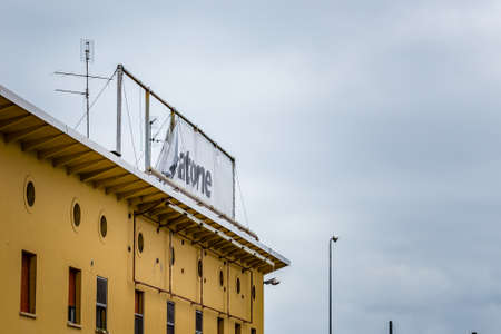 RUSSI (RA), ITALY - MAY 27, 2019: sunlight is enlightening logo of Mercatone Uno in folded banner on a gloomy day. Company went bankrupt last week