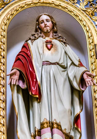 LUGO (RA), ITALY - MAY 27, 2019: light is enlightening the Sacred Heart in statue of Jesus Christ in Saint James Church